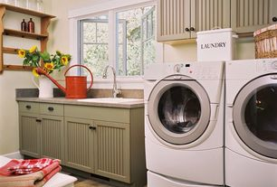 Cottage Laundry Room with terracotta tile floors, Ge 4.1 cu. ft. steam front-load washer & 7 cu. ft. dryer bundle - white