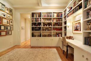 Contemporary Home Office with Box ceiling, Hardwood floors, Built-in bookshelf, Wall sconce
