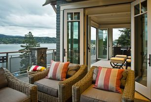 Traditional Patio with Outdoor wicker furniture, Balcony, outside french doors, shingle siding, Paint