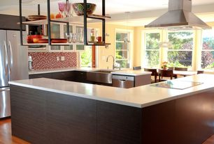 Contemporary Kitchen with French doors, Penny Tile, U-shaped, European Cabinets, Corian counters, Glass panel, Pendant light