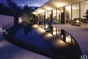 Contemporary Swimming Pool with Fence, exterior tile floors, Infinity pool