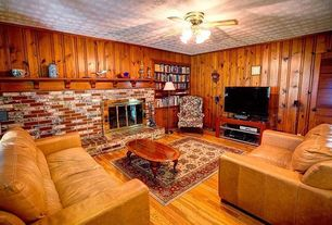 Country Living Room with Fireplace, Louvered door, brick fireplace, Crown molding, Ceiling fan, Built-in bookshelf