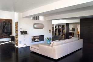 Modern Living Room with Laminate floors, Essen Sectional, Built-in bookshelf, Exposed beam