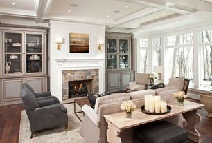 Traditional Living Room with Transom window, Coffee table, Woodland Imports Wood Console Table, Built-in bookshelf, Sofa