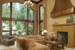 Traditional Great Room with Exposed beam, Cement fireplace, Crown molding, Fireplace, Carpet, Chandelier, picture window