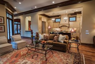 Traditional Great Room with French doors, Transom window, Built-in bookshelf, Ceiling fan, Standard height, Casement, Paint