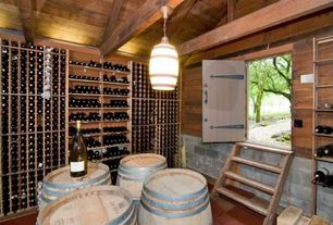 Country Wine Cellar with Built-in bookshelf, Brick floors, Barn door, Pendant light, Exposed beam