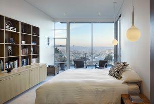 Modern Master Bedroom with Standard height, sliding glass door, can lights, Casement, Balcony, Carpet, Pendant light