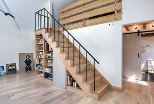 Rustic Staircase with Cathedral ceiling, Built-in bookshelf, Loft, Hardwood floors