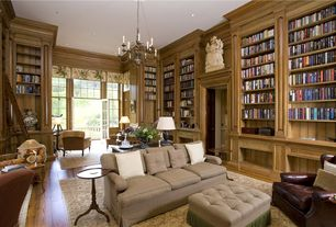 Traditional Library with French doors, Built-in bookshelf, Crown molding, Hardwood floors, Transom window, Chandelier