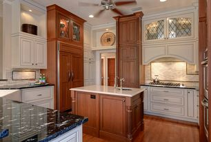 Traditional Kitchen with full backsplash, Ceramic Tile, Kitchen island, Glass panel, Custom hood, High ceiling, Crown molding