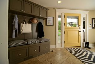 Traditional Mud Room with Casement, Glass panel door, can lights, Concrete tile , Built-in bookshelf, Standard height