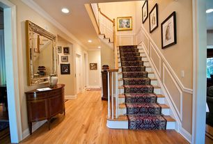 Traditional Staircase with curved staircase, Wainscotting, Hardwood floors, High ceiling