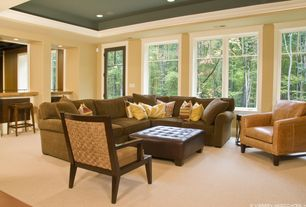 Modern Living Room with High ceiling, French doors, Carpet, Crown molding, can lights, picture window