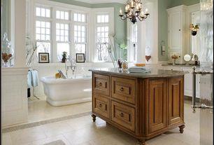 Traditional Master Bathroom with Crown molding, partial backsplash, Raised panel, stone tile floors, Chandelier, Freestanding