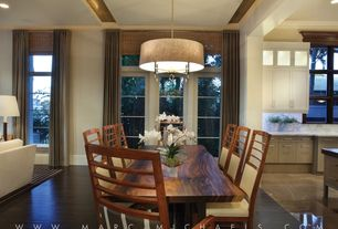 Contemporary Dining Room with Crown molding, Standard height, Laminate floors, Chandelier, picture window