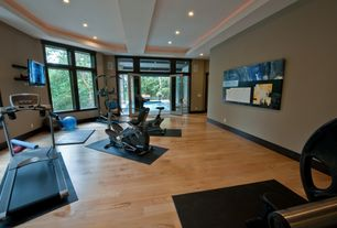 Contemporary Home Gym with Crown molding, Hardwood floors, F63 sole treadmill, Supermat 11gs tread mat, Exposed beam