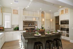 Kitchen with built-in microwave, can lights, full backsplash, electric cooktop, U-shaped, warming oven, Flat panel cabinets