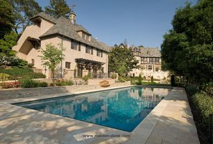 Traditional Swimming Pool with Deck Railing, Fence, Lap pool, Casement, exterior stone floors, French doors, Trellis