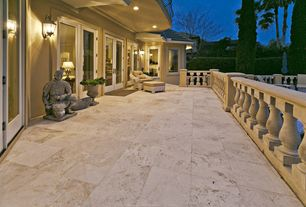 Mediterranean Deck with picture window, exterior stone floors, French doors, Deck Railing