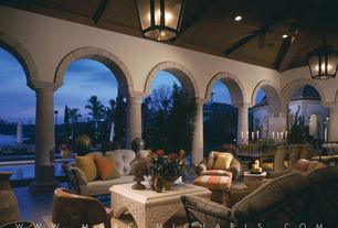 Mediterranean Porch with exterior stone floors, Wrap around porch, Fence