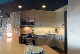 Modern Kitchen with Undermount sink, Corian-Solid Surface Countertop in Whisper, Ceramic Tile, U-shaped, Flush