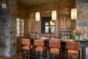 Rustic Bar with Hardwood floors, Standard height, can lights, Built-in bookshelf, Pendant light