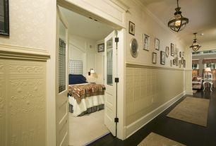 Traditional Hallway with interior wallpaper, Hardwood floors, Wainscotting, Crown molding, Pendant light, French doors