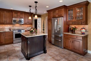 Craftsman Kitchen with MS International Caramel Travertine, limestone tile floors, Pendant light, Complex granite counters