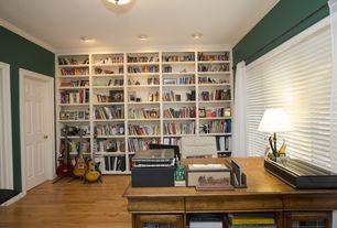 Traditional Home Office with Crown molding, Hardwood floors, six panel door, Standard height, can lights, Built-in bookshelf