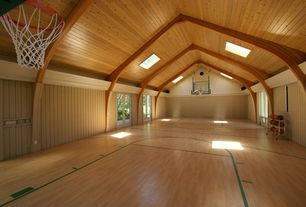 Contemporary Home Gym with Spalding 52-Inch Acrylic Backboard Combo, Exposed beam, Laminate floors, Skylight, High ceiling