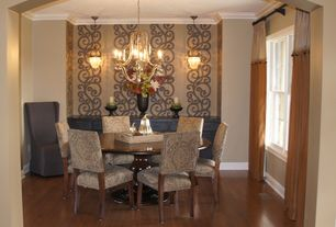 Traditional Dining Room with Crown molding, Pendant light, Standard height, double-hung window, Chandelier, Hardwood floors