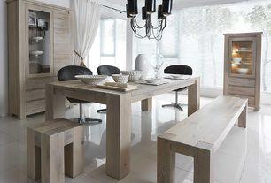 Contemporary Dining Room with Chandelier, Built-in bookshelf, Standard height, stone tile floors, sandstone tile floors