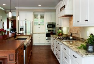 Traditional Kitchen with Complex granite counters, electric cooktop, double wall oven, Flat panel cabinets, Standard height