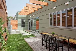 Contemporary Patio with exterior stone floors, Trellis, Fence