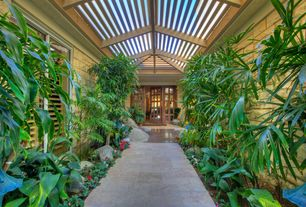 Tropical Landscape/Yard with Arbor, Blue Limestone Dimensional Pavers, Pathway, exterior stone floors, Skylight, French doors