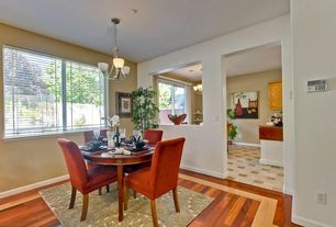 Contemporary Dining Room with Columns, picture window, Chandelier, Hardwood floors, Standard height