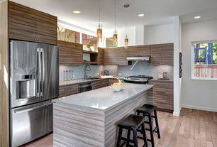 Contemporary Kitchen with Hardwood floors, Zebrawood cabinets, Black saddle seat stool, Flush, European Cabinets, L-shaped