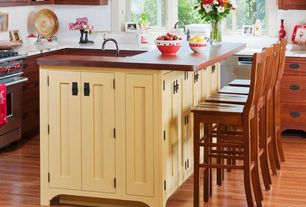 Country Kitchen with Wood counters, Flat panel cabinets, Inset cabinets, Complex marble counters, Breakfast bar, L-shaped