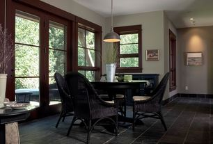 Craftsman Dining Room with Pendant light, French doors, soapstone tile floors