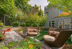 Contemporary Landscape/Yard with exterior concrete tile floors, Fence, specialty window, French doors, exterior tile floors