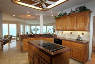 Traditional Kitchen with Limestone tile counters, Inset cabinets, Stone Tile, Limestone Tile, Kitchen island, L-shaped