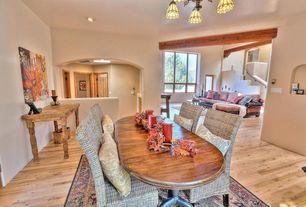 Eclectic Dining Room with Built-in bookshelf, Hardwood floors, Standard height, can lights, Chandelier