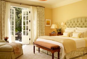 Traditional Master Bedroom with Paint, French doors, Carpet, Standard height, Tufted headboard, Crown molding