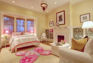 Traditional Kids Bedroom with stone fireplace, Bay window, Hardwood floors, Carter's Butterfly Flowers Rug, Chandelier