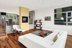 Modern Living Room with Standard height, Hardwood floors, Fireplace, insert fireplace, can lights, Sunken living room