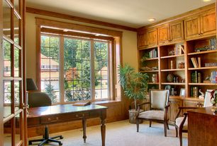 Traditional Home Office with Crown molding, Wainscotting, Casement, Built-in bookshelf, Window seat, Carpet, French doors