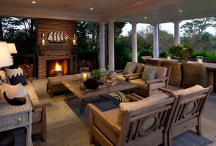 Traditional Porch with Area rug, Paint, Wrap around porch, exterior stone floors, Whitecraft sonoma wicker lounge chair