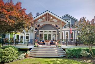Traditional Exterior of Home with Skylight, Pathway, Deck Railing, French doors, picture window, Transom window