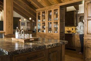 Rustic Kitchen with Kitchen island, Inset cabinets, MSI Granite Counters in Supreme Fantasy, Exposed beam, High ceiling